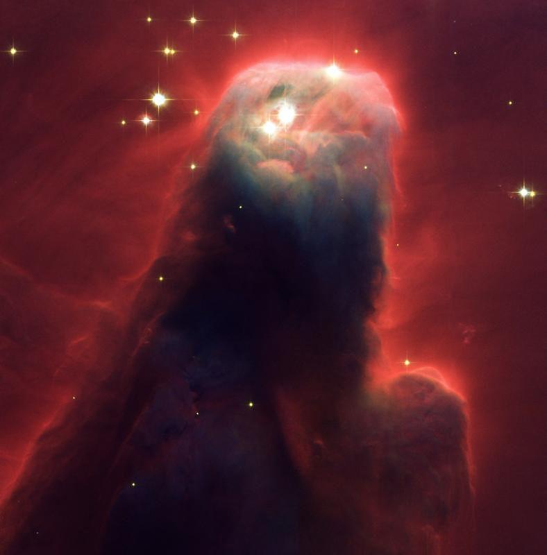 8. Туманность конус NGC 2264 в созвездии Единорога. Эта туманность входит в систему туманностей, окружающих звездное скопление Снежинки.
